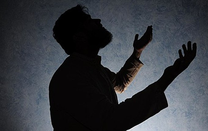 Silhouette of a man praying @ Walton United Church, Oakville, Ontario